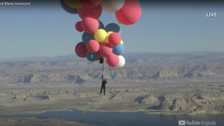 Balloon man? David Blaine hangs from 50 helium balloons over Arizona desert