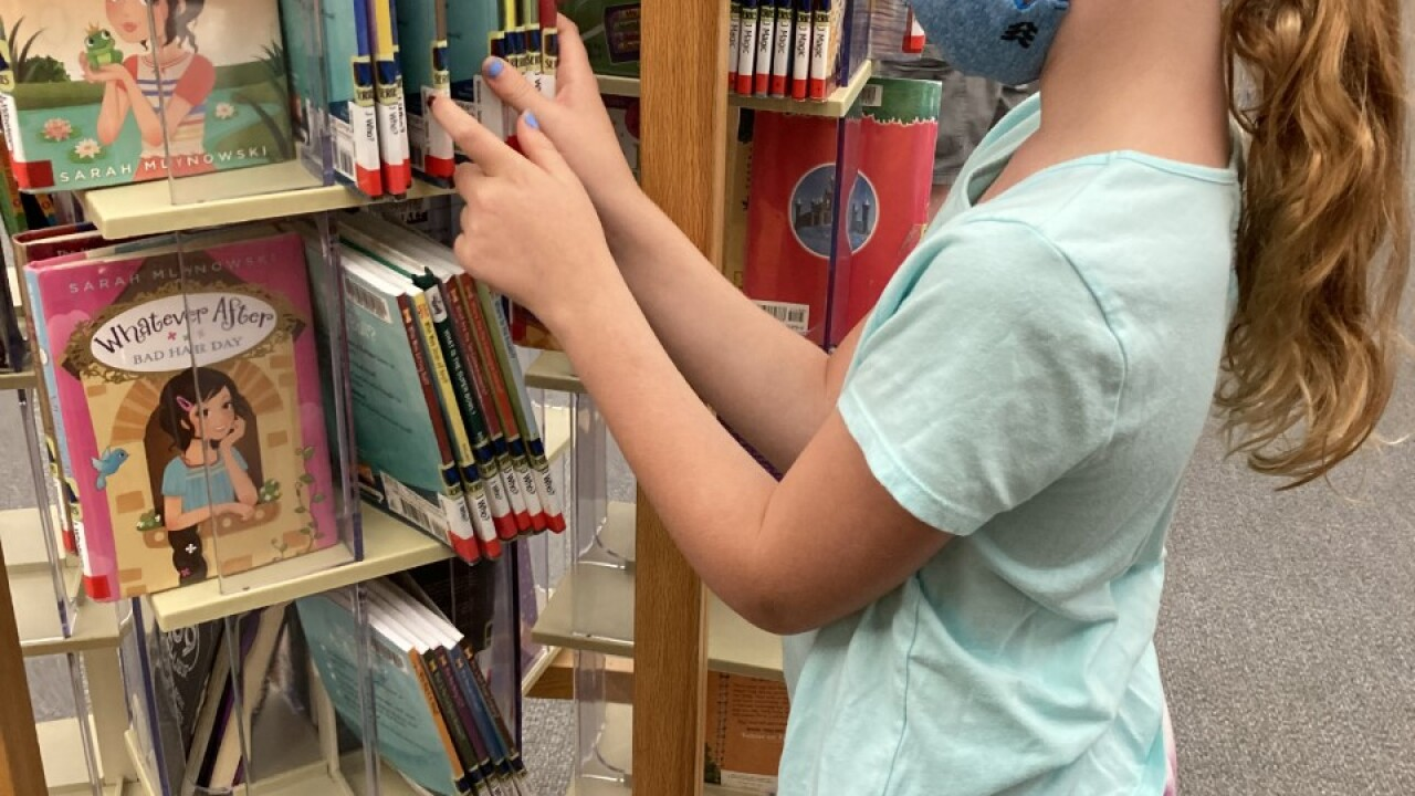 9-year-old Lauren McEneany searches for her next book