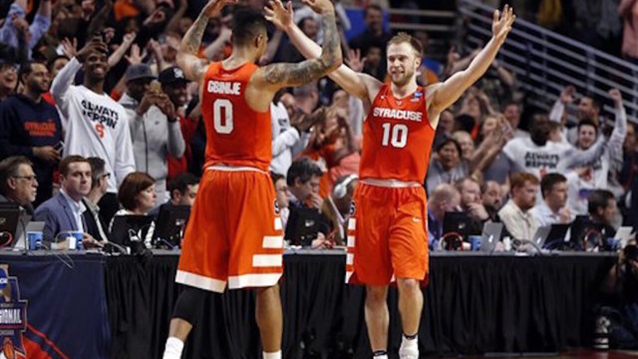 Syracuse shocks Virginia, rallies for win