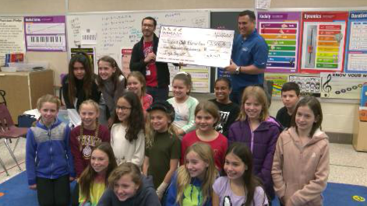 Red Mill Elementary receives $2,500 check for winning jingle-sing off contest