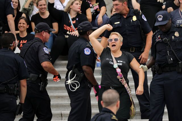 Photos: Protesters gather to oppose Kavanaugh confirmation