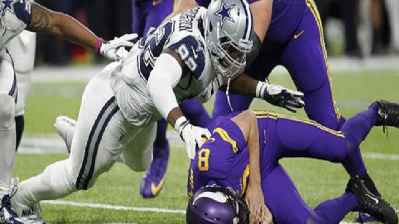 Cowboys hold on against Vikings for 11th straight win