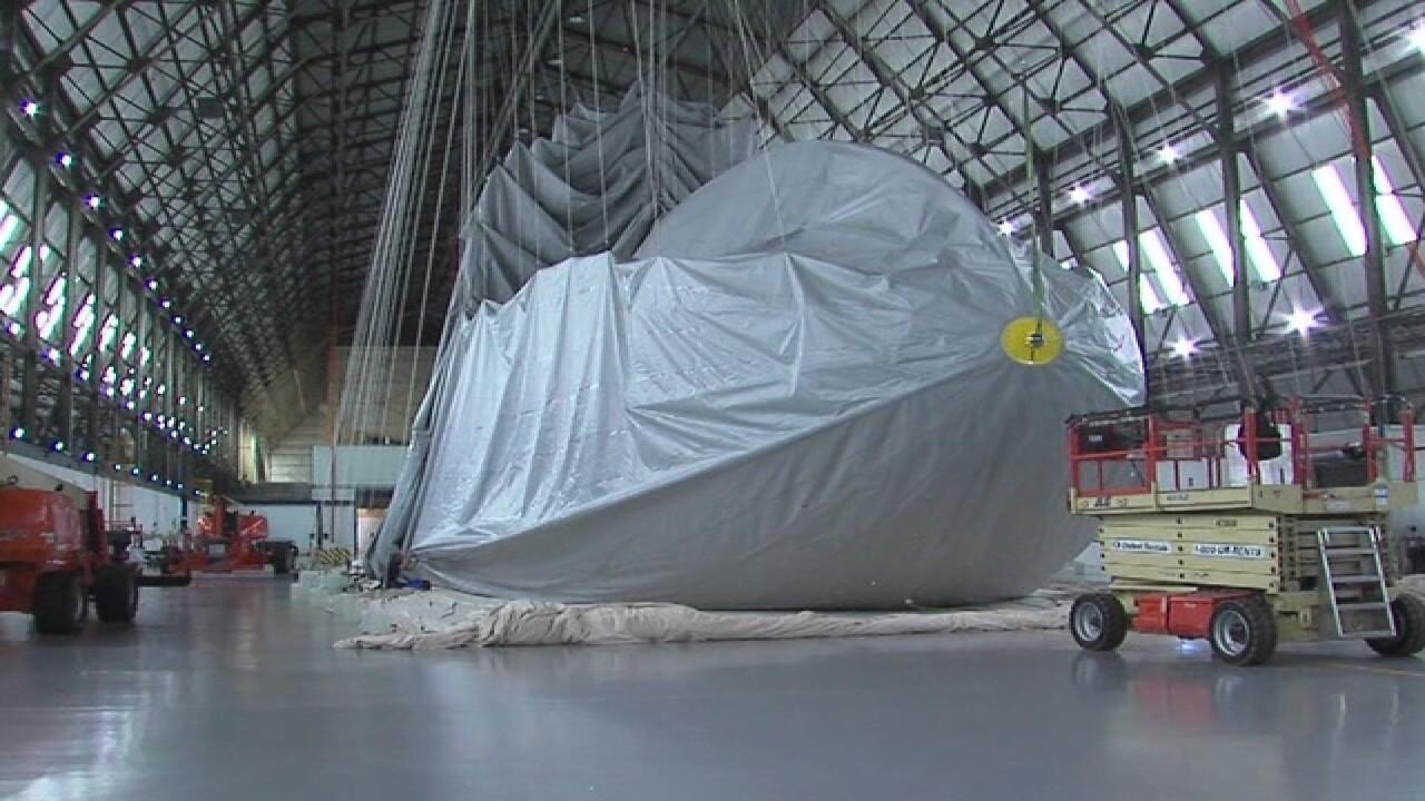 New Goodyear blimp rising from the hangar floor