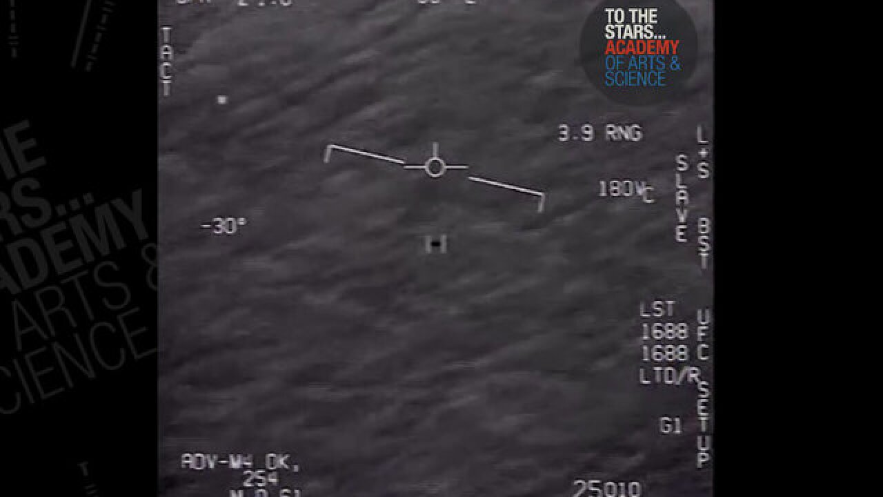 Video appears to show Navy jet encounter with possible UFO speeding across the sky
