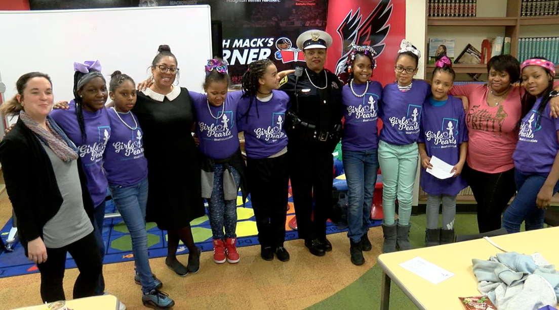Girls with Pearls from Ethel M. Taylor Academy next to Cincinnati Police Officer Princess Davis