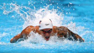 Caeleb Dressel ties Olympic record in 100m butterfly prelim