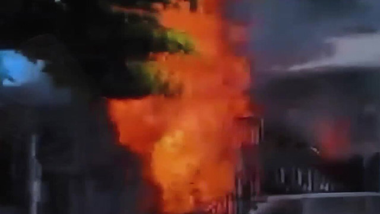 Car packed with propane smashes into apartments