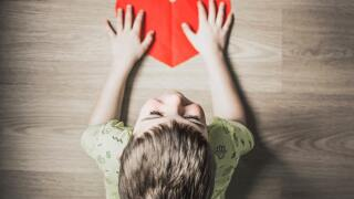 Child holding a heart