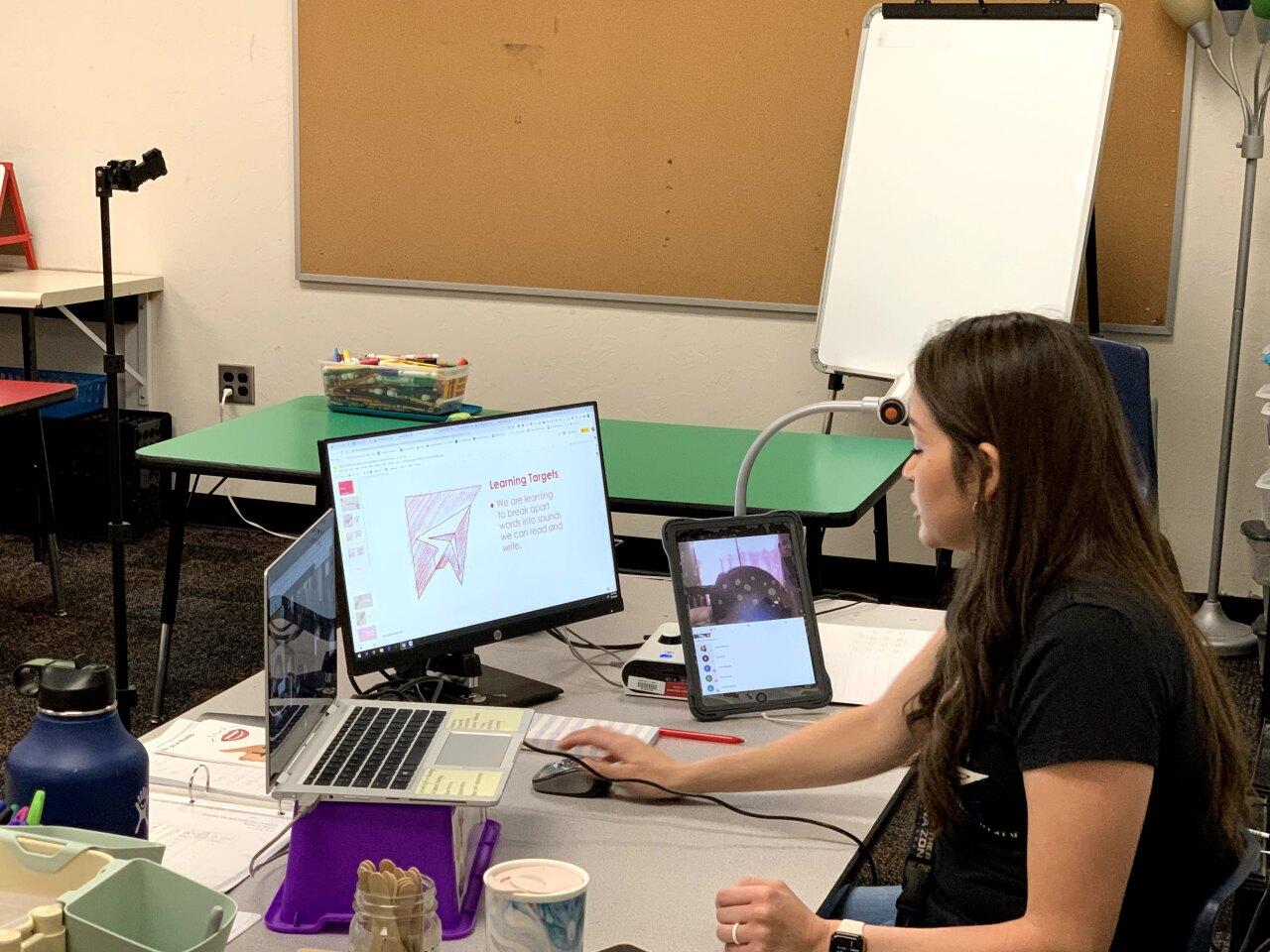1st Grade teacher Anissa Jimenez working remotely