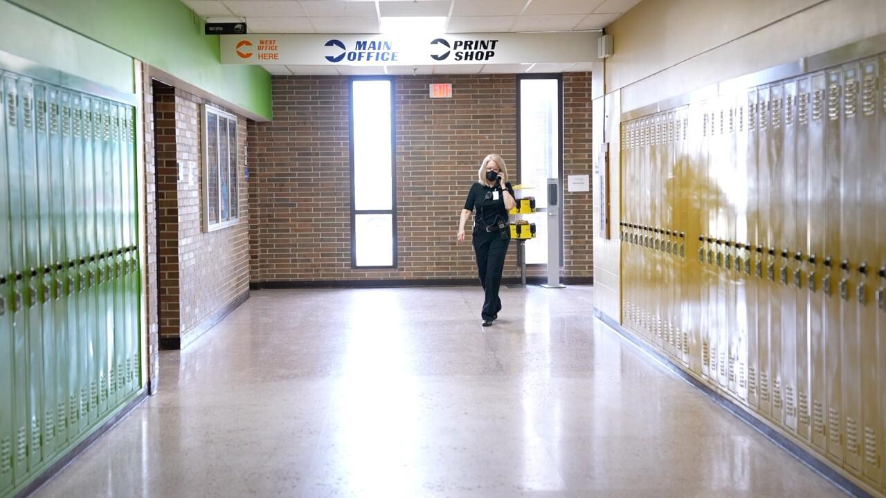 Jan Bidwell walks down a hallway.