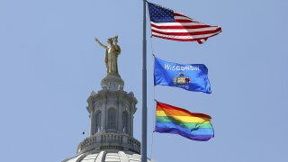 A rainbow flag observing Pride Month is displayed over the east wing of the Wisconsin State Capitol in Madison, Wis., Friday, June 7, 2019.