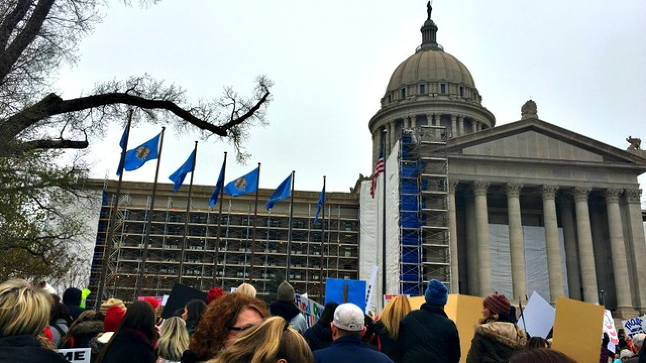 Teachers with disabilities march at the capitol