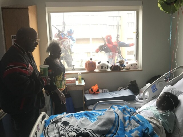 Photo gallery: Superheroes wash windows at Detroit Children's Hospital