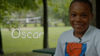 9-year-old Oscar dreams of riding bikes and playing games with his adoptive parents