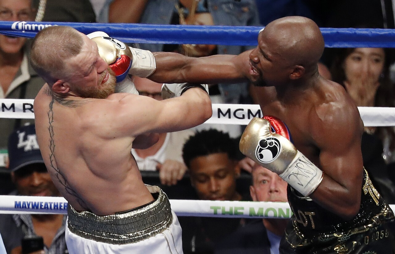 Floyd Mayweather lands punch on Conor McGregor in 2017
