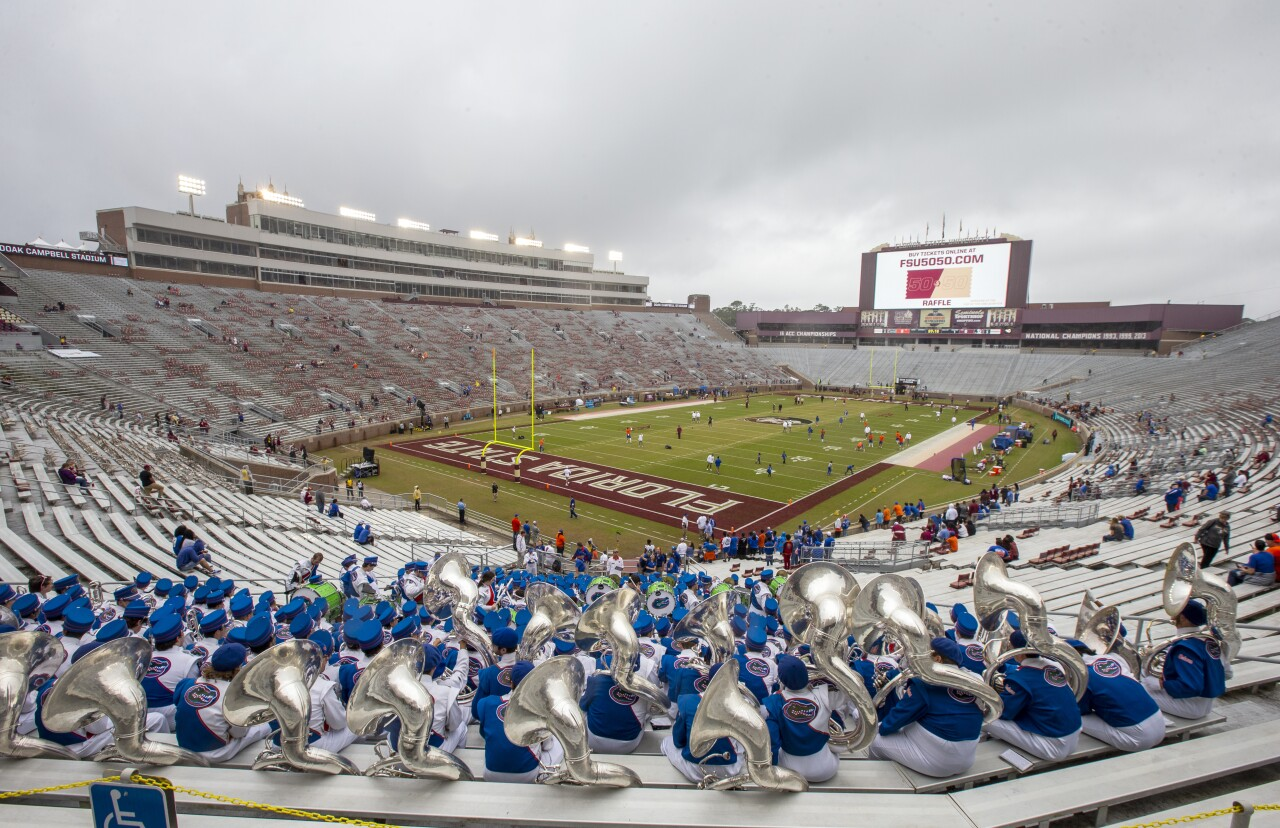 Florida Gators band sits in empty Doak S. Campbell Stadium before game against Florida State Seminoles in 2018