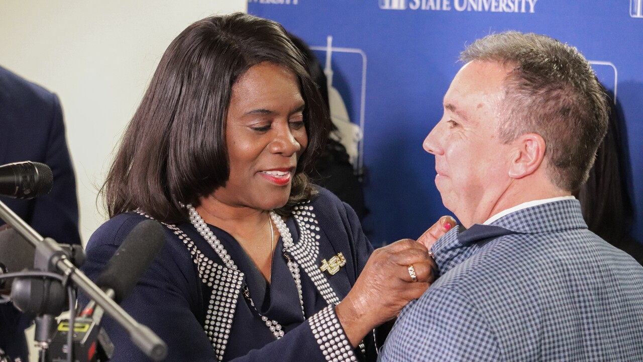 Dr. Glover pinning Henry into TSU family.jpeg