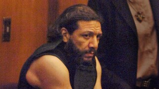Jorge Barahona in handcuffs and shackles in 2011