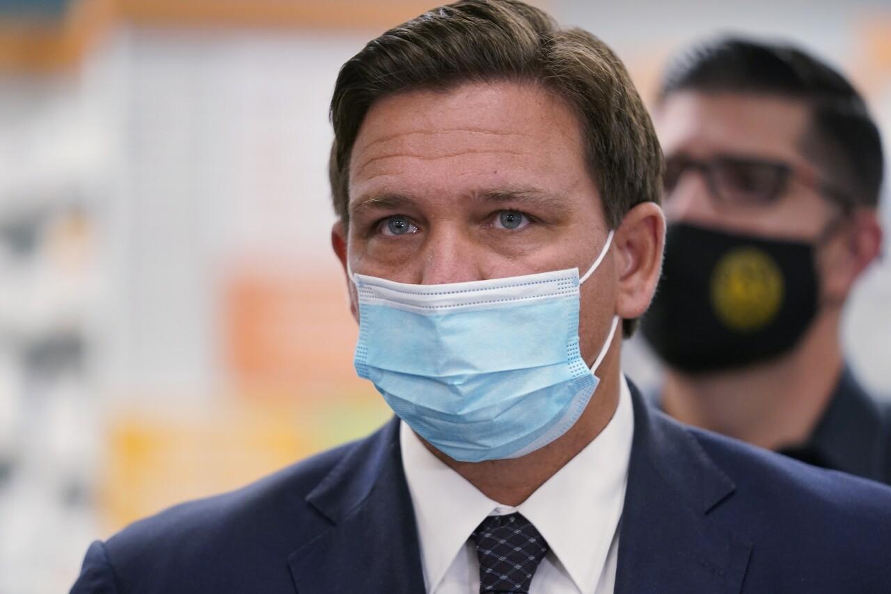Gov. Ron DeSantis wearing mask at Navarro Discount Pharmacy in Hialeah, Feb. 23, 2021
