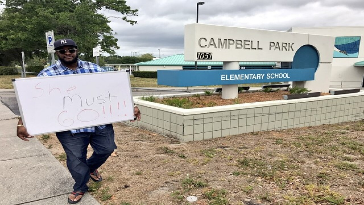 Parents urge 'racist' principal be fired