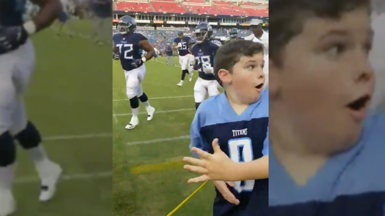 Young Fan's Reaction To High-Fiving Marcus Mariota Is Priceless