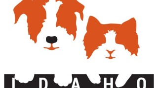 """The logo of the Idaho Humane Society featuring an orange silhouette of a dog and cat with the """"Idaho"""" written in a brown box at the bottom."""