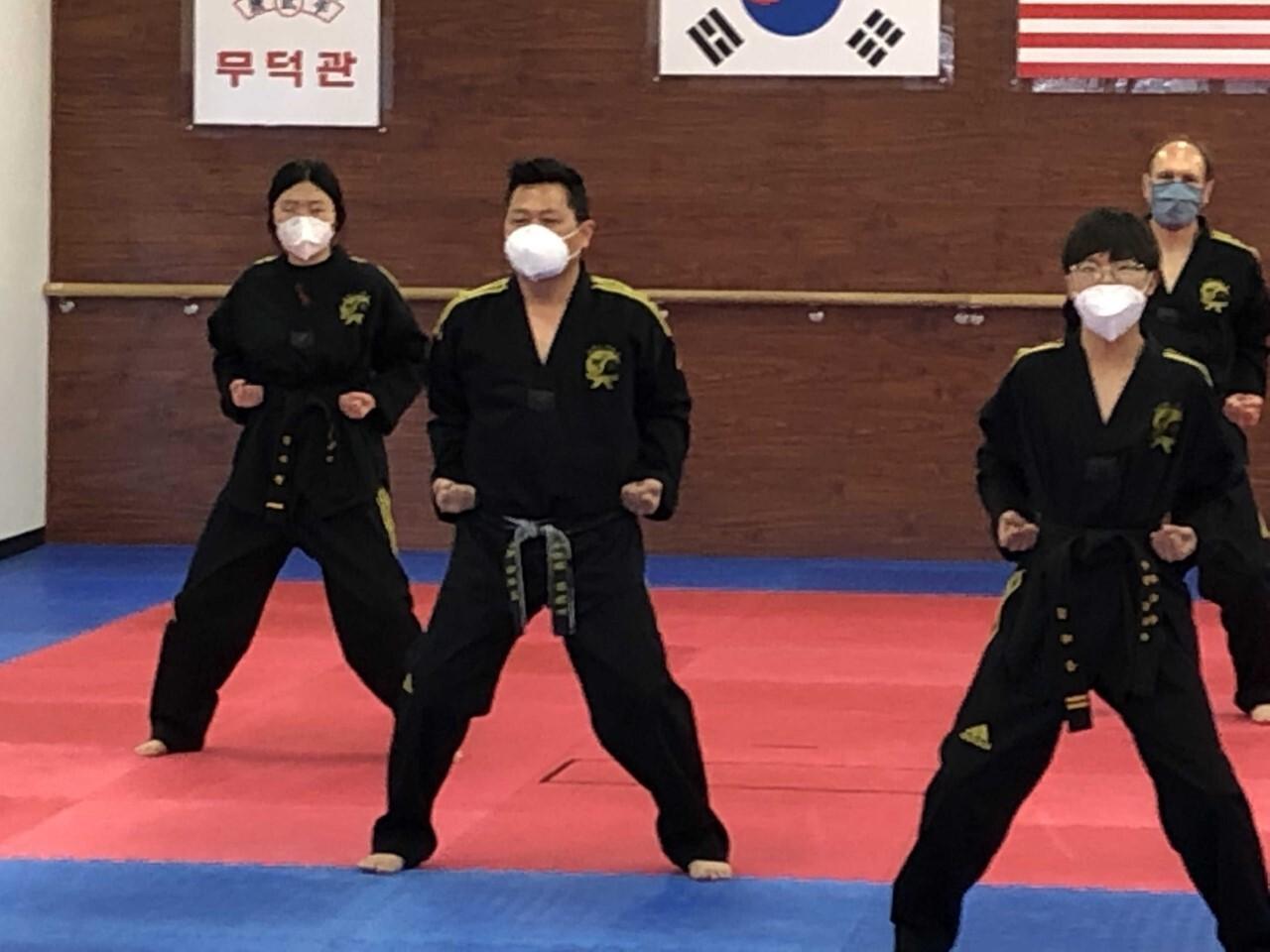 Douglas Kim leading class