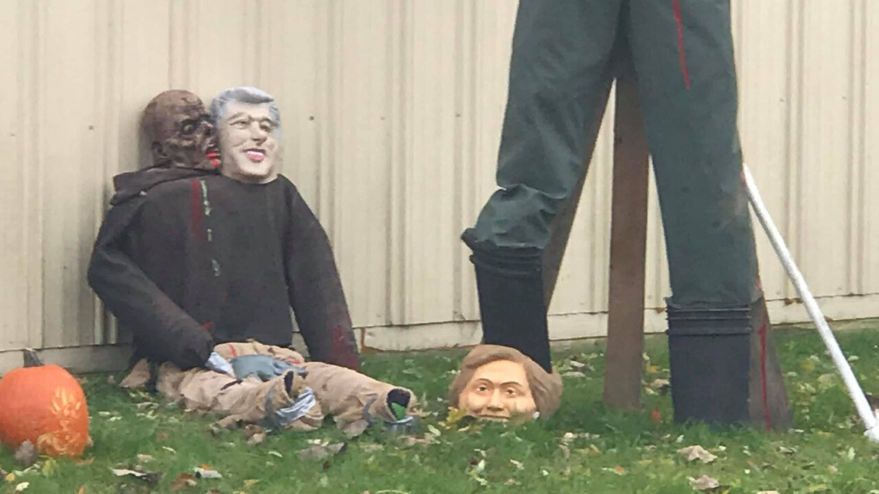 Michigan auto shop owner switches up Halloween decoration of Trump holding Obama's head on rope