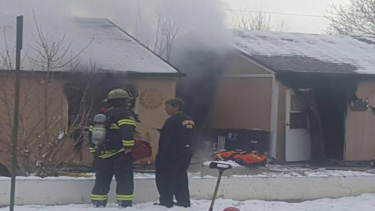 Firefighter burned battling south Denver blaze