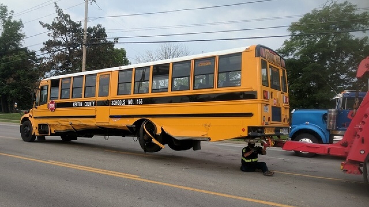 Woman charged with OVI after hitting school bus
