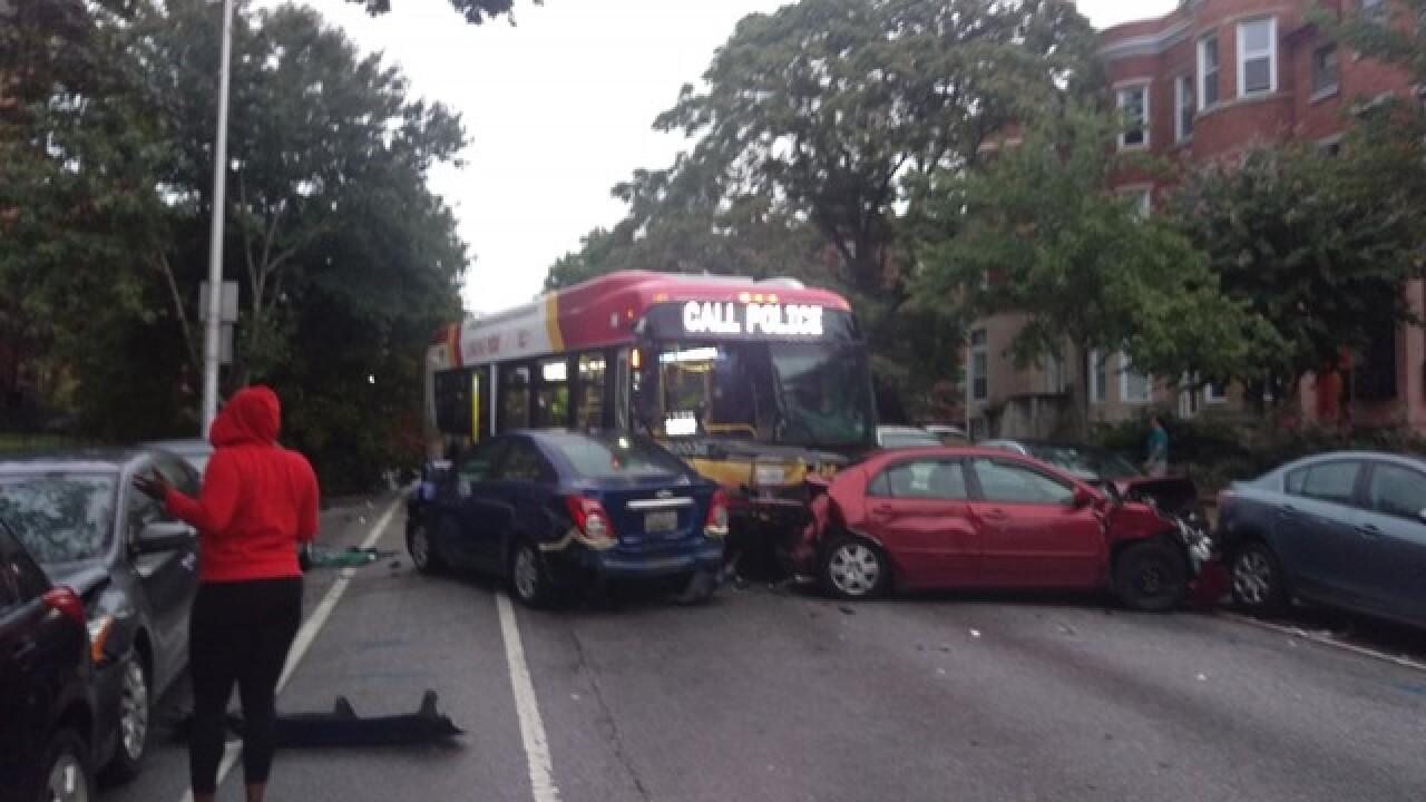 Car runs red light, strikes bus