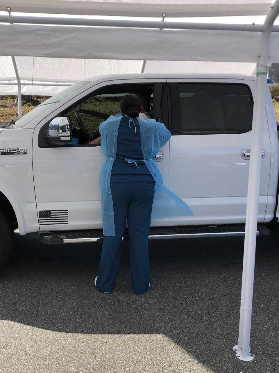 TCC nursing student administering a vaccine at TMH drive through clinic