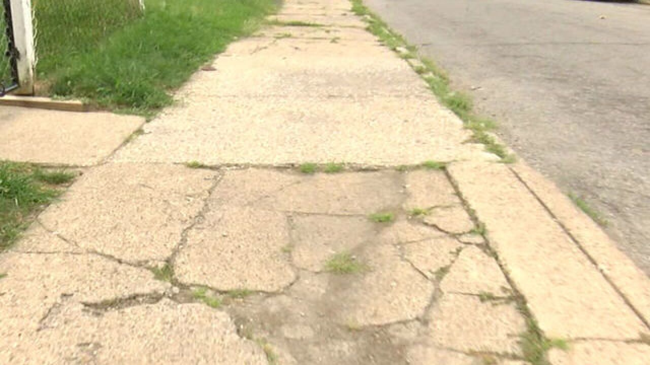 Damaged sidewalk reported year before wife falls