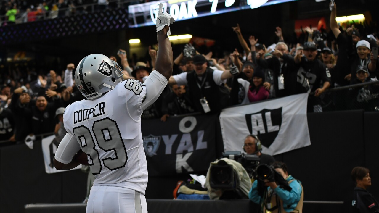 Cowboys trade first round pick for Raiders' Amari Cooper