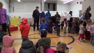 Firefighters give new coats to Great Falls kids