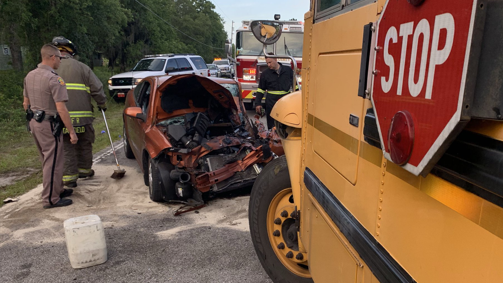 Driver extricated from car, three students injured after