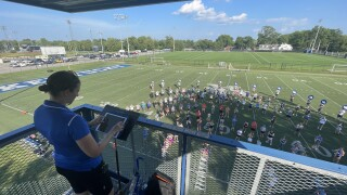 Dr. Shayna Stahl leads the Wildcat Marching Band during rehearsal