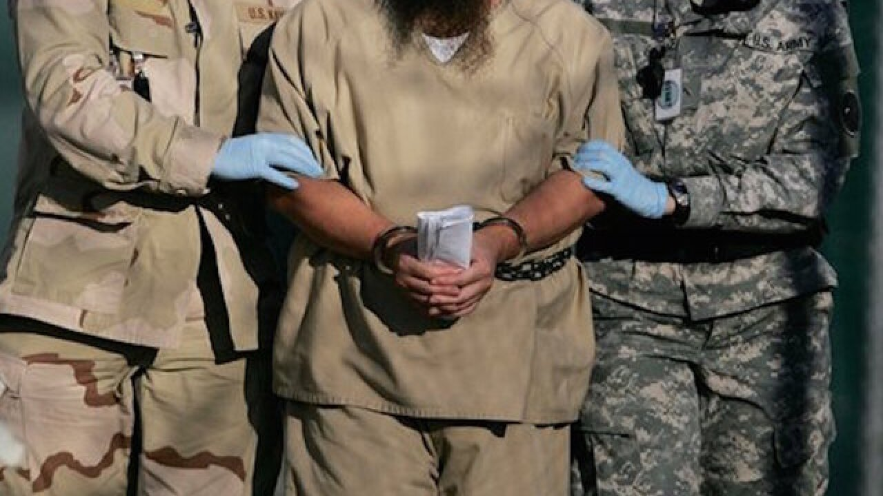 Obama shrinks Guantanamo population