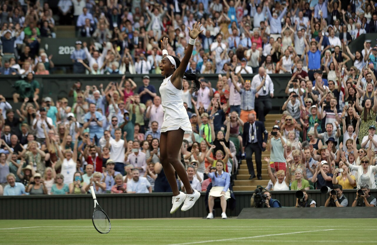 Coco Gauff celebrates after beating Polona Hercog at Wimbledon in 2019