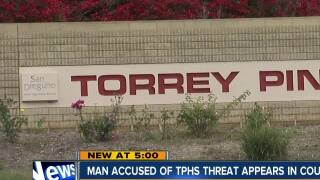 Man charged in school threat to remain in custody