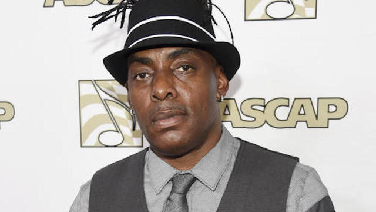 Rapper Coolio pleads guilty to bringing gun to airport