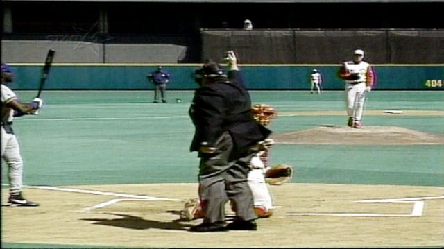 Umpire John McSherry signals toward second base before trying to leave the field.