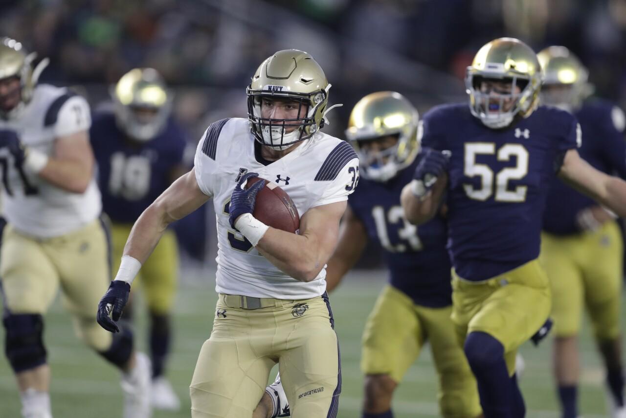 Navy Midshipmen fullback Isaac Ruoss runs vs. Notre Dame Fighting Irish