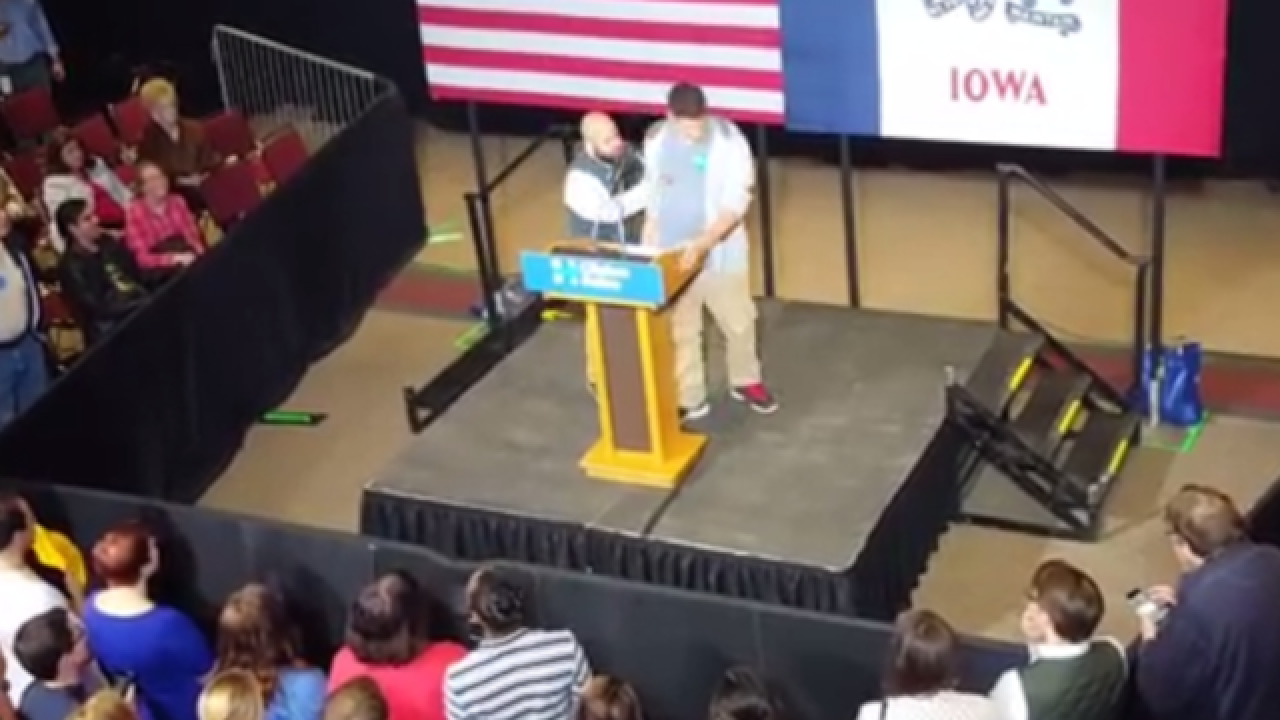 Student escorted off stage after trashing Hillary Clinton at her own rally