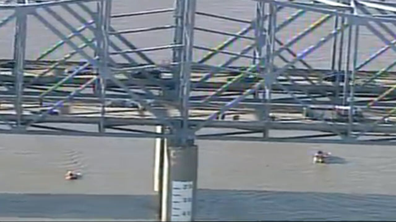 Car falls off Cincinnati bridge and into river