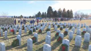 Volunteers sought to lay holiday wreaths on the graves of veterans in the Flathead