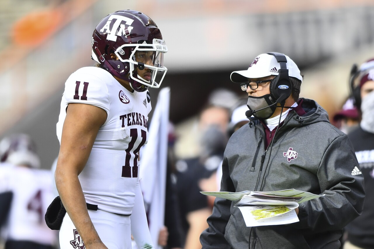 Texas A&M Aggies QB Kellen Mond speaks to Jimbo Fisher on sideline at Tennessee Volunteers in 2020