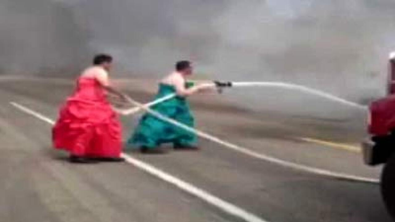 Firemen in dresses put out truck fire