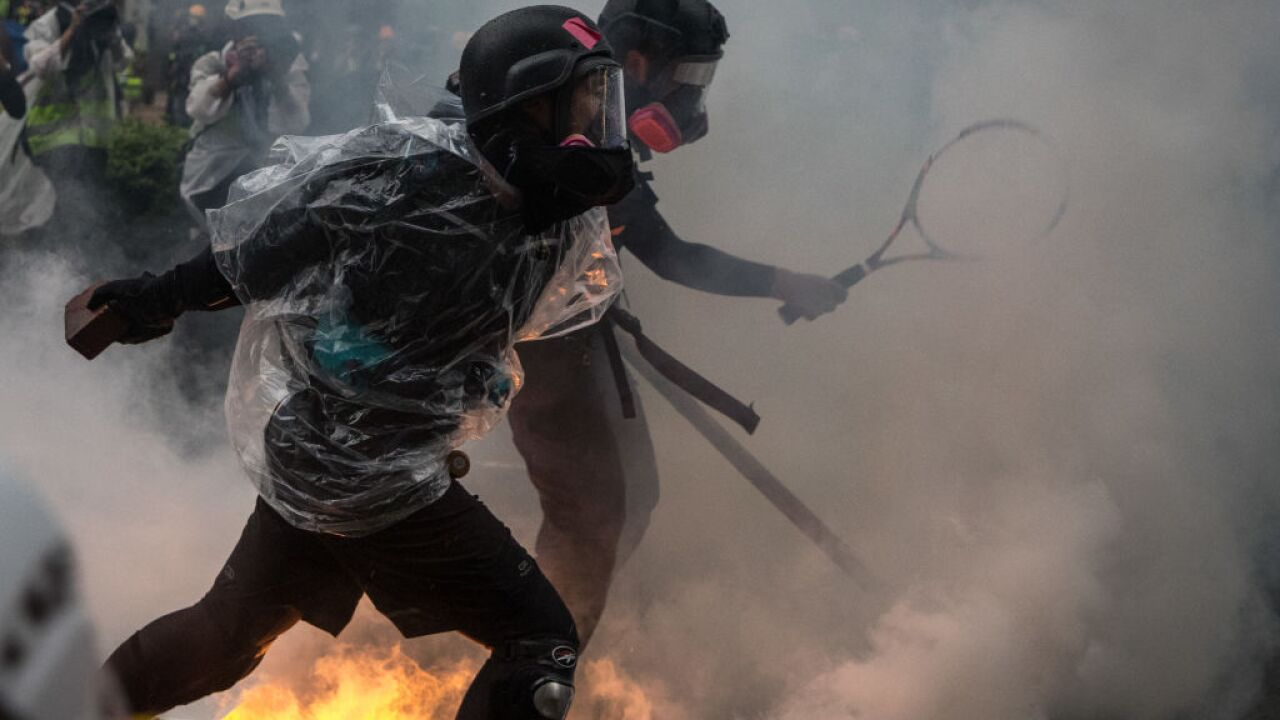 A gun shot, petrol bombs and water cannons mark violent escalation in Hong Kong protests