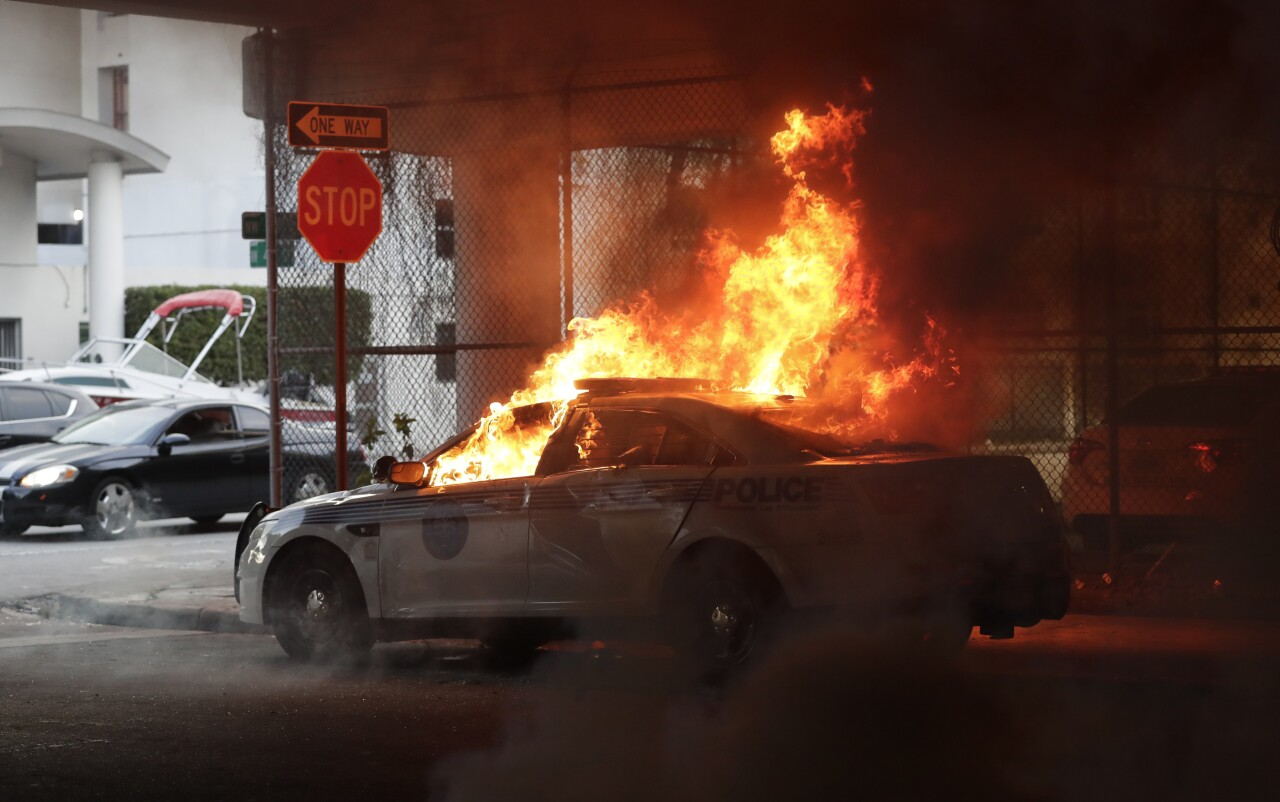 Miami police cruiser burns during protests May 30